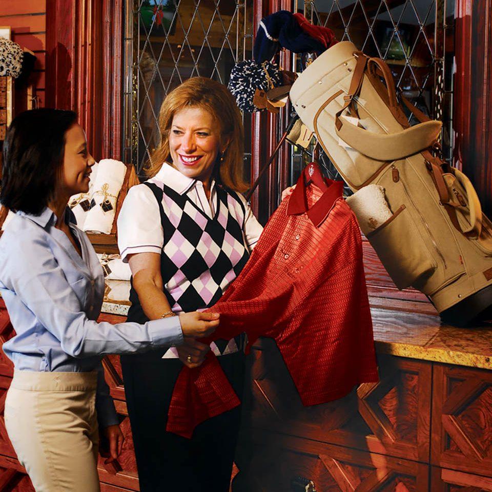 friendly pro shop staff member assisting a customer